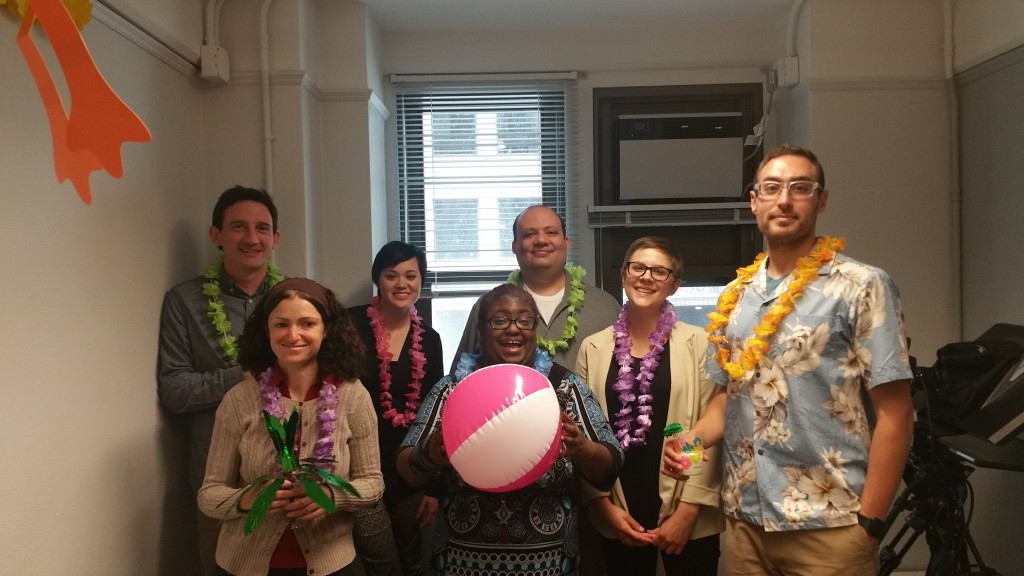 DL staff members with leis and a beach ball.