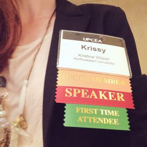 Krissy Wilson name badge with UPCEA Member, Speaker, and First Time Attendee labels.