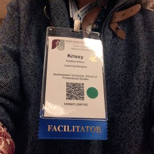 Krissy Wilson's name badge with Facilitator label.